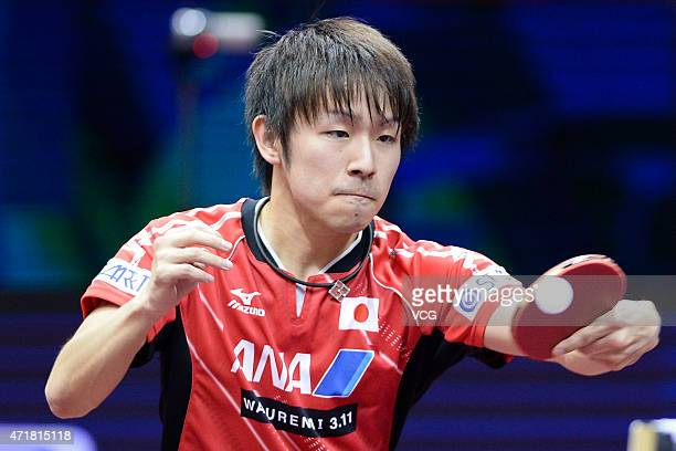 Koki Niwa of Japan competes against Fan Zhendong of China during the fourth round of men's singles match on day six of the 2015 World Table Tennis...