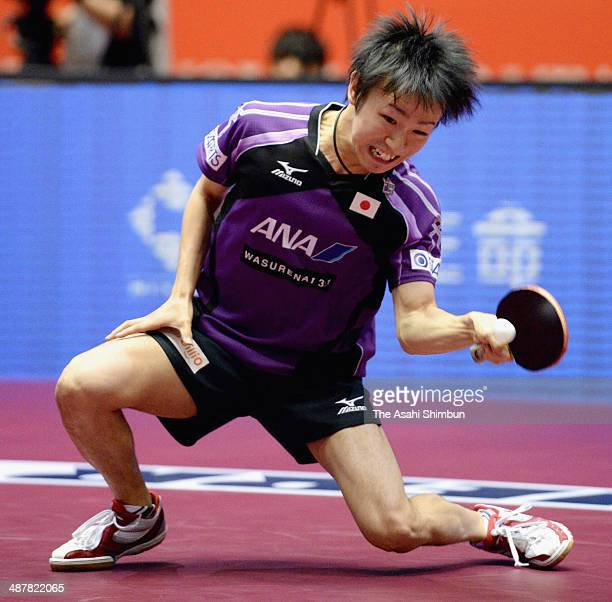 Koki Niwa of Japan competes in the game against Marcos Freitas of Portugal during day five of the 2014 World Team Table Tennis Championships at...