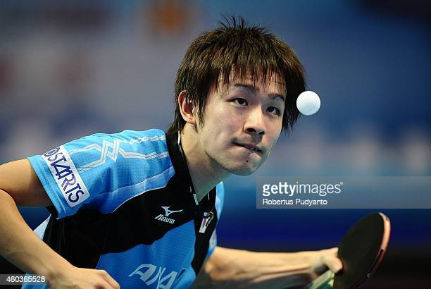 Koki Niwa of Japan in action during the Men's singles round of 16 of the 2014 ITTF World Tour Grand Finals at Huamark Indoor Stadium on December 12...