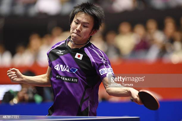 Koki Niwa of Japan plays a fore hand against Marcos Freitas of Portugal during day five of the 2014 World Team Table Tennis Championships at Yoyogi...