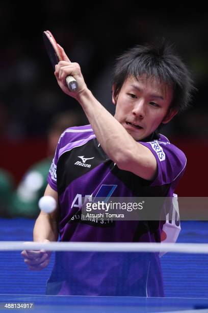 Koki Niwa of Japan plays a forehand against Timo Boll of Germany during day seven of the 2014 World Team Table Tennis Championships at Yoyogi...