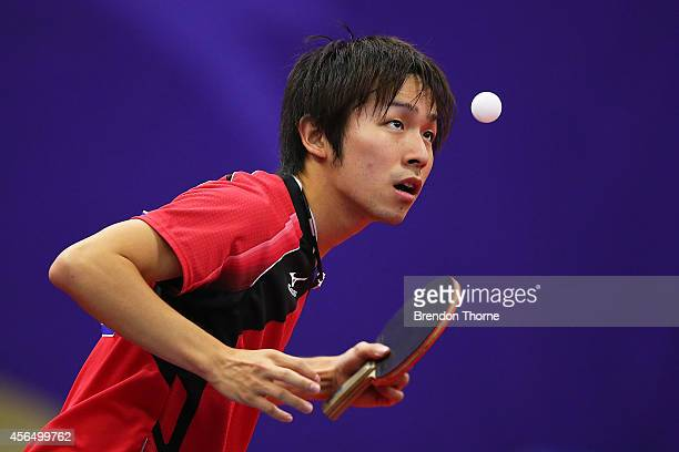 Koki Niwa of Japan serves in his Round of 16 Elimination Match against Afshin Noroozi of Iran during day thirteen of the 2014 Asian Games at Suwon...