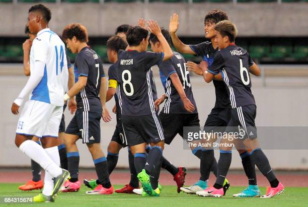 Koki Ogawa of Japan celebrates scoring the opening goal with his team mates during the U20 international friendly match between Japan and Honduras at...