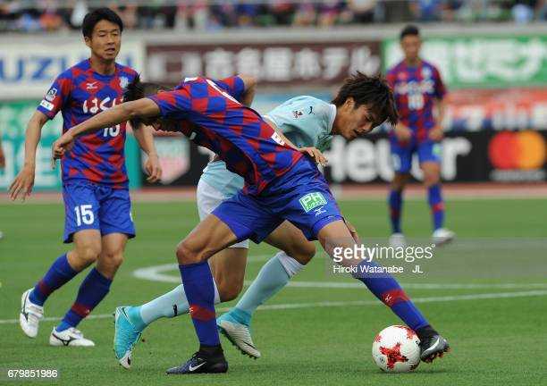 Koki Ogawa of Jubilo Iwata and Eder Lima of Ventforet Kofu compete for the ball during the JLeague J1 match between Ventforet Kofu and Jubilo Iwata...