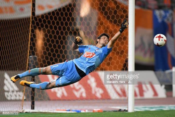 Koki Otani of Albirex Niigata dives for the ball during the JLeague J1 match between Albirex Niigata and Vegalta Sendai at Denka Big Swan Stadium on...