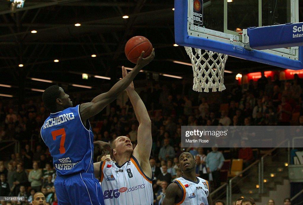 Koko Archibong of Bayreuth shoots against Andrew Drevo of Bremerhaven during the Basketball Bundesliga match between Eisbaeren Bremerhaven and BBC...