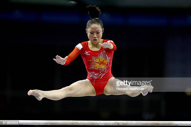 Koko Tsurumi of Japan competes in the uneven bars during the Apparatus Finals on the fifth day of the Artistic Gymnastics World Championships 2009 at...