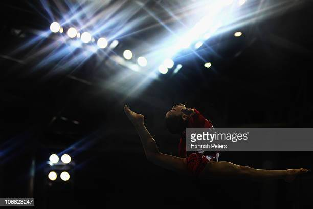 Koko Tsurumi of Japan competes in the Women's Team Final beam discipline at the Asian Games Town Gymnasium during day two of the 16th Asian Games...