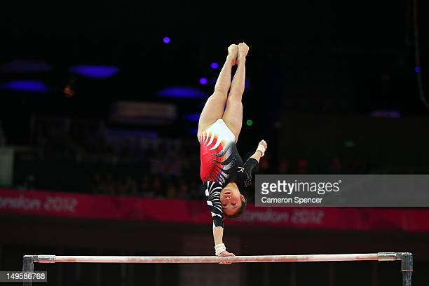 Koko Tsurumi of Japan competes on the uneven bars in the Artistic Gymnastics Women's Team final on Day 4 of the London 2012 Olympic Games at North...
