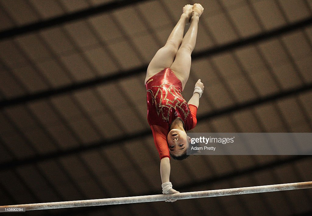 Koko Tsurumi of Japan performs her uneven bars routine during day two of the Artistic Gymnastics NHK Trophy at Yoyogi National Gymnasium on May 5, 2012 in Tokyo, Japan.