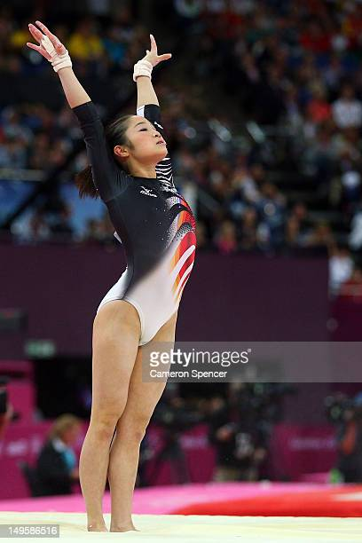Koko Tsurumi of Japan reacts after competing in the uneven bars in the Artistic Gymnastics Women's Team final on Day 4 of the London 2012 Olympic...