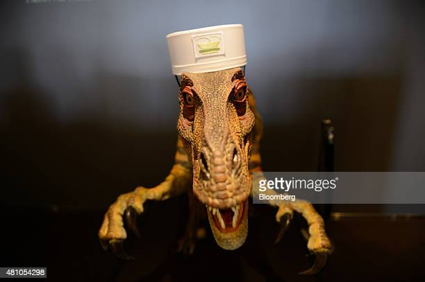 A Kokoro Company Ltd dinosaur robot stands at the reception desk of Henn na Hotel operated by Huis Ten Bosch Co a unit of HIS Co in Sasebo Nagasaki...
