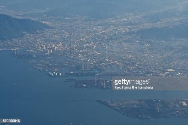 Kokura area in Kitakyushu city in Fukuoka prefecture in Japan sunset time aerial view from airplane