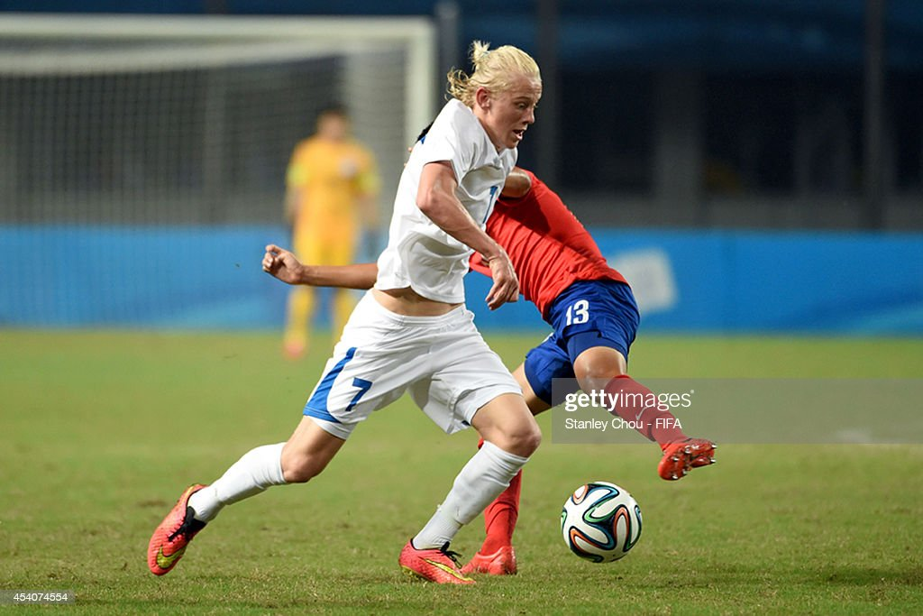 Kolbeinn Finnsson of Iceland is tackled by Hong Hyunseok of Korea Republic during the 2014 FIFA Boys Summer Youth Olympic Football Tournament Semi Final match between Korea Republic and Iceland at Jiangning Sports Centre Stadium on August 24, 2014 in Nanjing, China.