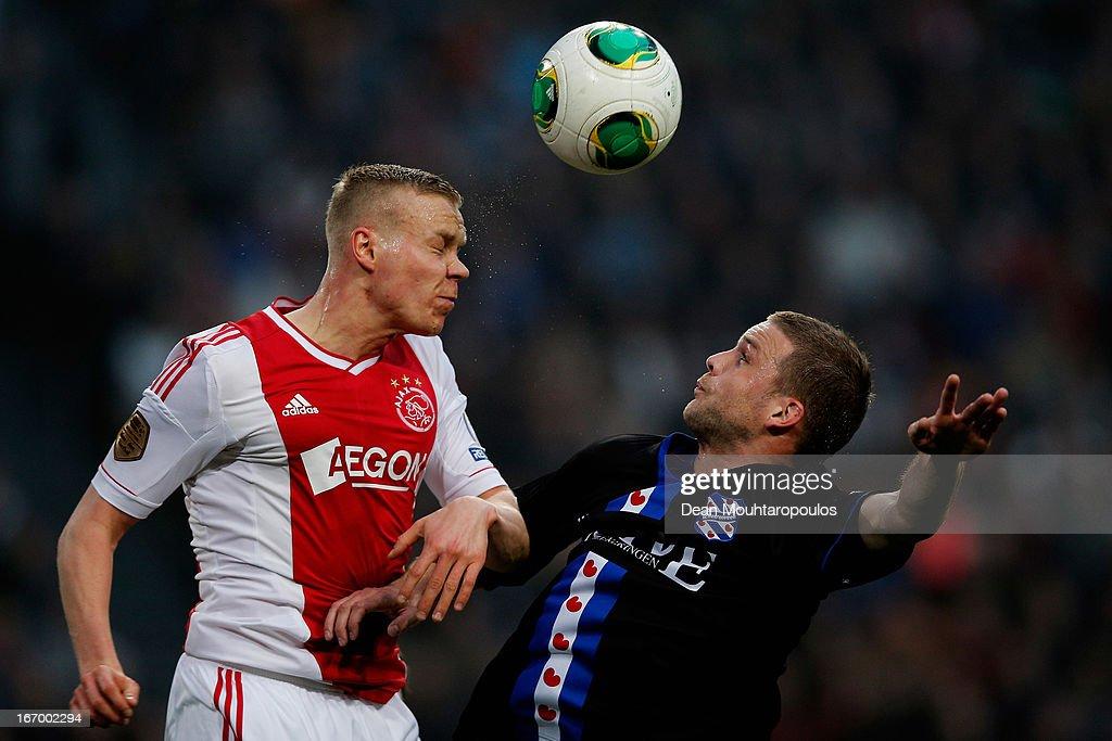 Kolbeinn Sigthorsson of Ajax and Jeffrey Gouweleeuw of Heerenveen battle for the header during the Eredivisie match between Ajax Amsterdam and SC Heerenveen at Amsterdam Arena on April 19, 2013 in Amsterdam, Netherlands.