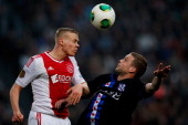 Kolbeinn Sigthorsson of Ajax and Jeffrey Gouweleeuw of Heerenveen battle for the header during the Eredivisie match between Ajax Amsterdam and SC...