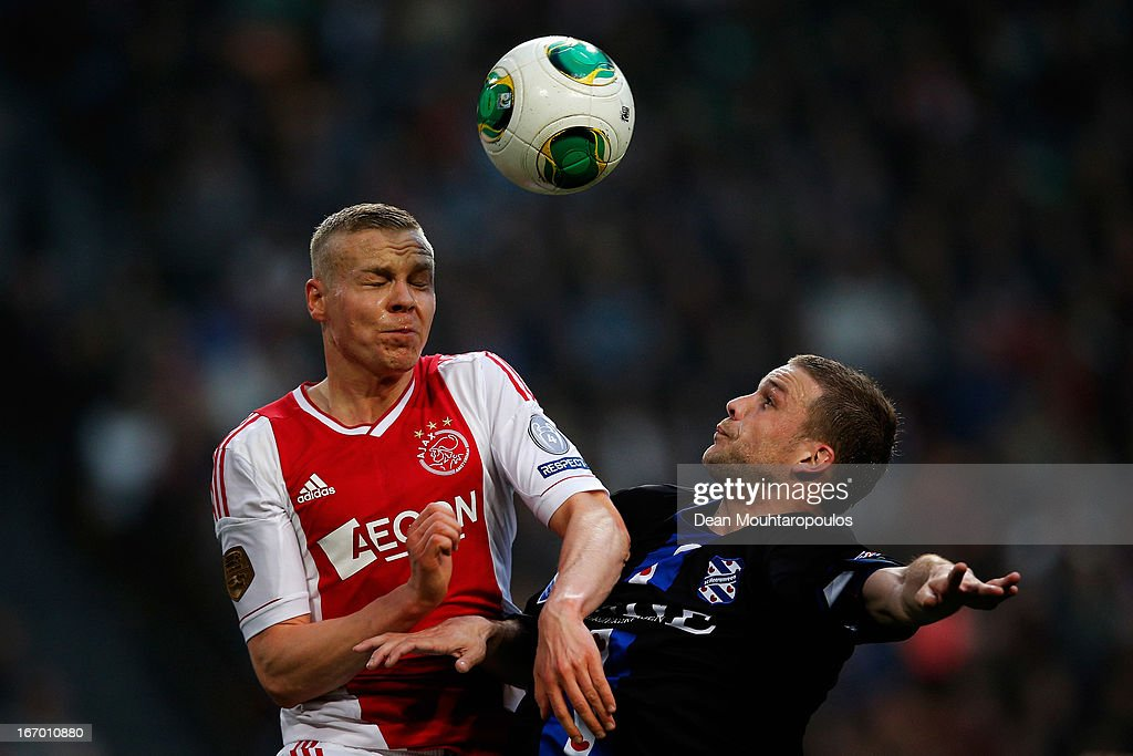 <a gi-track='captionPersonalityLinkClicked' href=/galleries/search?phrase=Kolbeinn+Sigthorsson&family=editorial&specificpeople=4649188 ng-click='$event.stopPropagation()'>Kolbeinn Sigthorsson</a> of Ajax and Jeffrey Gouweleeuw of Heerenveen battle for the header during the Eredivisie match between Ajax Amsterdam and SC Heerenveen at Amsterdam Arena on April 19, 2013 in Amsterdam, Netherlands.