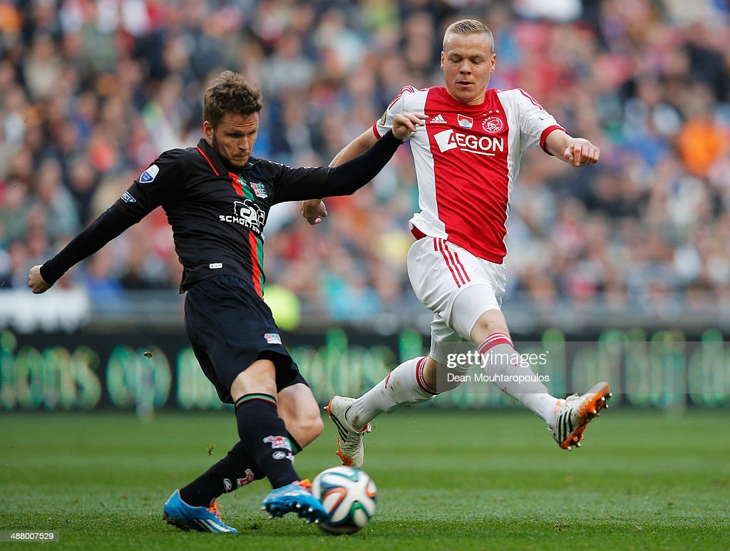 Kolbeinn Sigthorsson of Ajax attempts to stop Lasse Nielsen of NEC from clearing the ball during the Eredivisie match between Ajax Amsterdam and NEC...