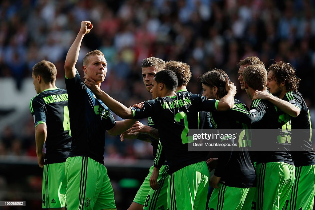 Kolbeinn Sigthorsson of Ajax celebrates scoring the first goal of the game towards the fans during the Eredivisie match between PSV Eindhoven and Ajax Amsterdam at Philips Stadion on April 14, 2013 in Eindhoven, Netherlands.