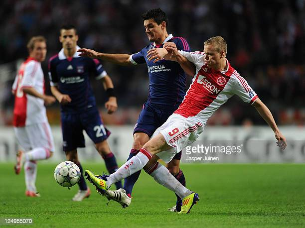 Kolbeinn Sigthorsson of Ajax duels for the ball with Clement Grenier of Olympique Lyonnais during the UEFA Champions League group D match between AFC...