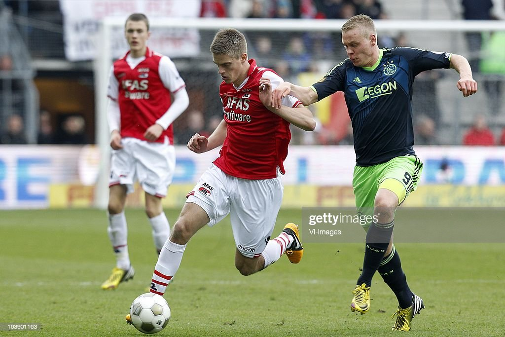 Kolbeinn Sigthorsson of Ajax (R), Markus Henriksen of AZ (L) during the Dutch Eredivisie match between AZ Alkmaar and Ajax Amsterdam at the AFAS Stadium on march 17, 2013 in Alkmaar, The Netherlands