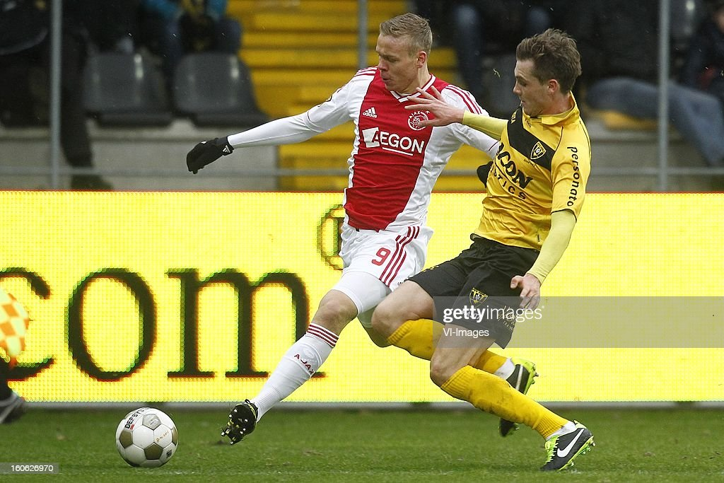 Kolbeinn Sigthorsson of Ajax (L), Nils Roseler of VVV-Venlo (R) during the Dutch Eredivisie match between VVV-Venlo and Ajax Amsterdam at stadium De Koel on february 3, 2013 in Venlo, The Netherlands