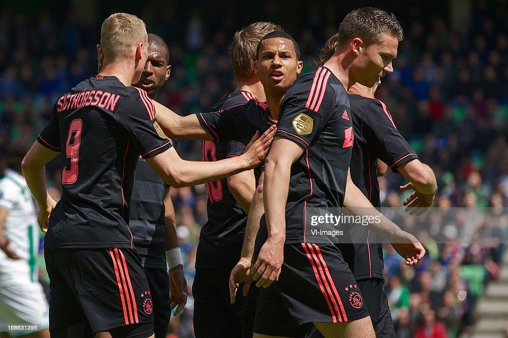 Kolbeinn Sigthorsson of Ajax, Ryan Babel of Ajax, Ricardo van Rhijn of Ajax, Derk Boerrigter of Ajax during the Dutch Eredivisie match between FC Groningen and Ajax on May 12, 2013 at the Euroborg stadium in Groningen, The Netherlands.