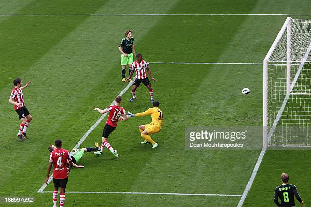 Kolbeinn Sigthorsson of Ajax shoots and scores the first goal of the game past goalkeeper Boy Waterman of PSV during the Eredivisie match between PSV...