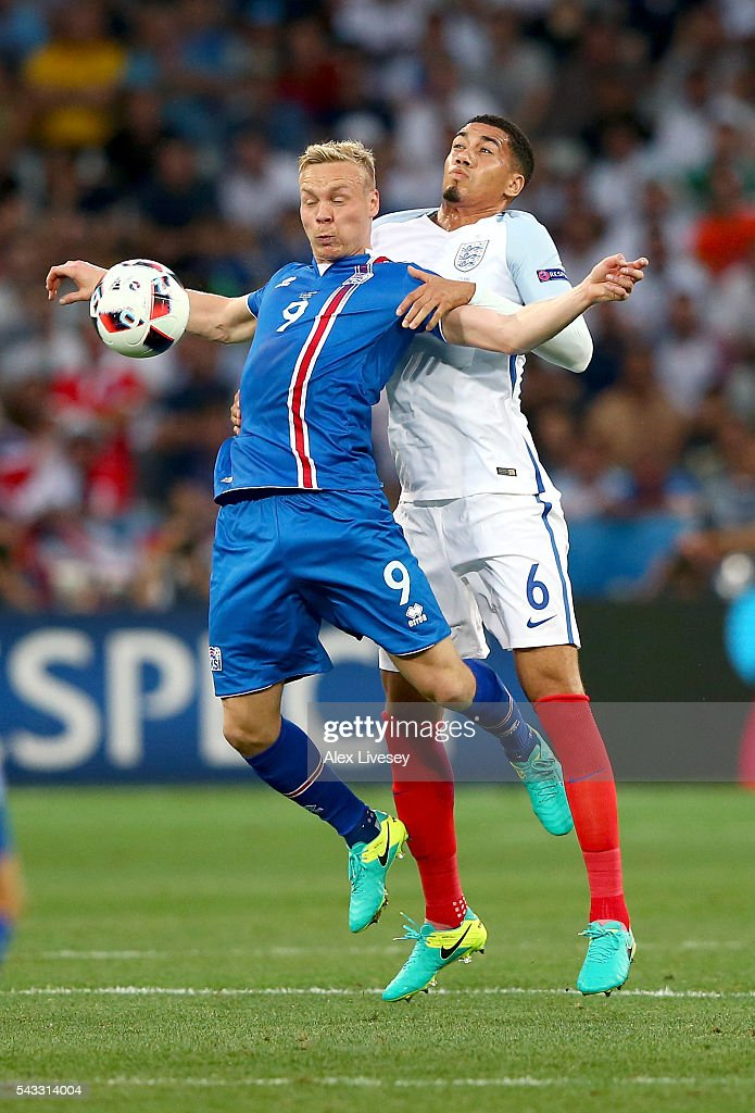 <a gi-track='captionPersonalityLinkClicked' href=/galleries/search?phrase=Kolbeinn+Sigthorsson&family=editorial&specificpeople=4649188 ng-click='$event.stopPropagation()'>Kolbeinn Sigthorsson</a> of Iceland controls the ball under pressure of <a gi-track='captionPersonalityLinkClicked' href=/galleries/search?phrase=Chris+Smalling&family=editorial&specificpeople=5964313 ng-click='$event.stopPropagation()'>Chris Smalling</a> of England during the UEFA EURO 2016 round of 16 match between England and Iceland at Allianz Riviera Stadium on June 27, 2016 in Nice, France.