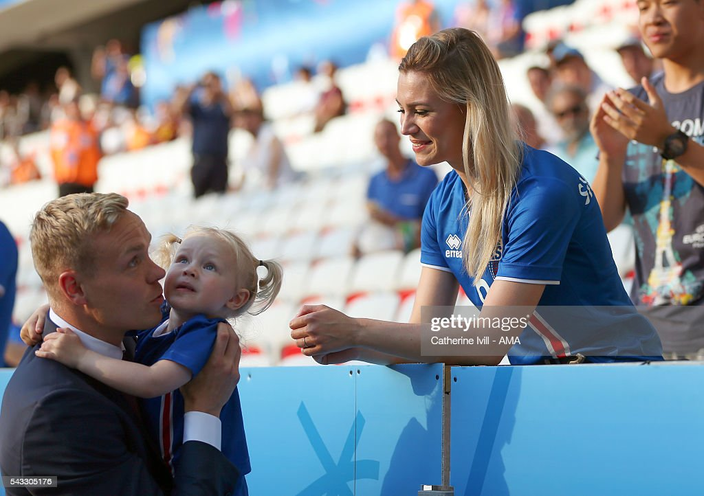 <a gi-track='captionPersonalityLinkClicked' href=/galleries/search?phrase=Kolbeinn+Sigthorsson&family=editorial&specificpeople=4649188 ng-click='$event.stopPropagation()'>Kolbeinn Sigthorsson</a> of Iceland greets his wife and daughter before the match during the UEFA EURO 2016 Round of 16 match between England and Iceland at Allianz Riviera Stadium on June 27, 2016 in Nice, France.