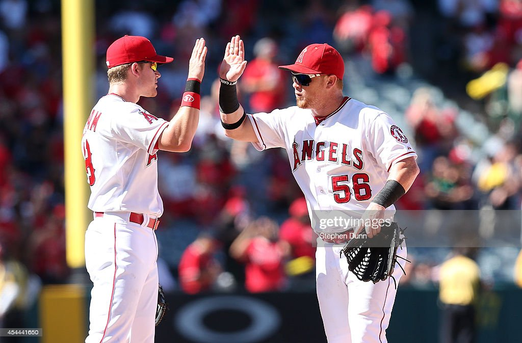 <a gi-track='captionPersonalityLinkClicked' href=/galleries/search?phrase=Kole+Calhoun&family=editorial&specificpeople=9008672 ng-click='$event.stopPropagation()'>Kole Calhoun</a> #56 and <a gi-track='captionPersonalityLinkClicked' href=/galleries/search?phrase=Gordon+Beckham&family=editorial&specificpeople=5411079 ng-click='$event.stopPropagation()'>Gordon Beckham</a> #18 of the Los Angeles Angels of Anaheim celebrate after the game with the Oakland Athletics at Angel Stadium of Anaheim on August 31, 2014 in Anaheim, California. The Angels won 8-1 to complete a four game sweep.