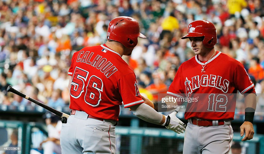 <a gi-track='captionPersonalityLinkClicked' href=/galleries/search?phrase=Kole+Calhoun&family=editorial&specificpeople=9008672 ng-click='$event.stopPropagation()'>Kole Calhoun</a> #56 and <a gi-track='captionPersonalityLinkClicked' href=/galleries/search?phrase=Johnny+Giavotella&family=editorial&specificpeople=7512348 ng-click='$event.stopPropagation()'>Johnny Giavotella</a> #12 of the Los Angeles Angels of Anaheim celebrate after Giavotella scored a run in the first inning during their game against the Houston Astros at Minute Maid Park on July 28, 2015 in Houston, Texas.