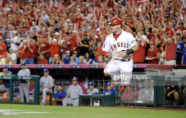 Kole Calhoun of the Los Angeles Angels celebrates after scoring in the sixth inning against the Kansas City Royals during Game Two of the American...