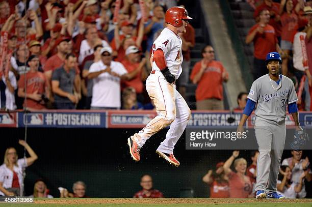 Kole Calhoun of the Los Angeles Angels celebrates after scoring inthe sixth inning against the Kansas City Royals during Game Two of the American...