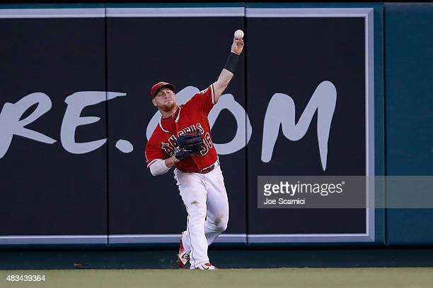 Kole Calhoun of the Los Angeles Angels makes a throw from the outfield in the sixth inning against the Baltimore Orioles at Angel Stadium of Anaheim...