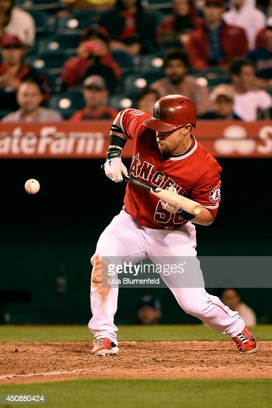 Kole Calhoun of the Los Angeles Angels of Anaheim attempts a bunt against the Oakland Athletics at Angel Stadium of Anaheim on June 10 2014 in...
