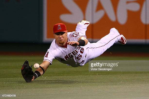 Kole Calhoun of the Los Angeles Angels of Anaheim can't make the catch on a fly ball to right field by Colby Rasmus of the Houston Astros in the...