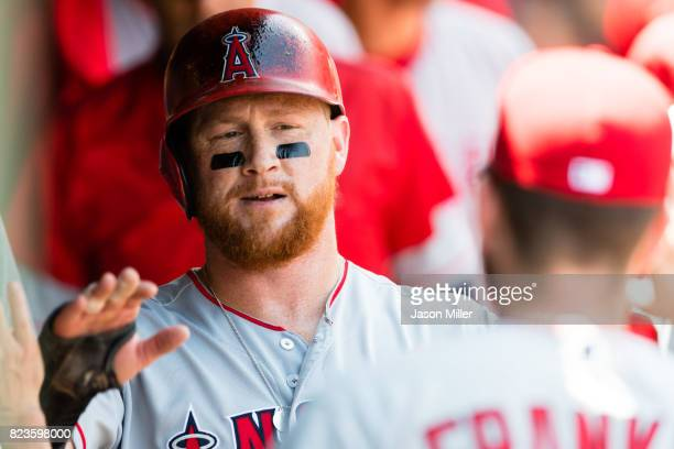 Kole Calhoun of the Los Angeles Angels of Anaheim celebrates after scoring during the fifth inning against the Cleveland Indians at Progressive Field...