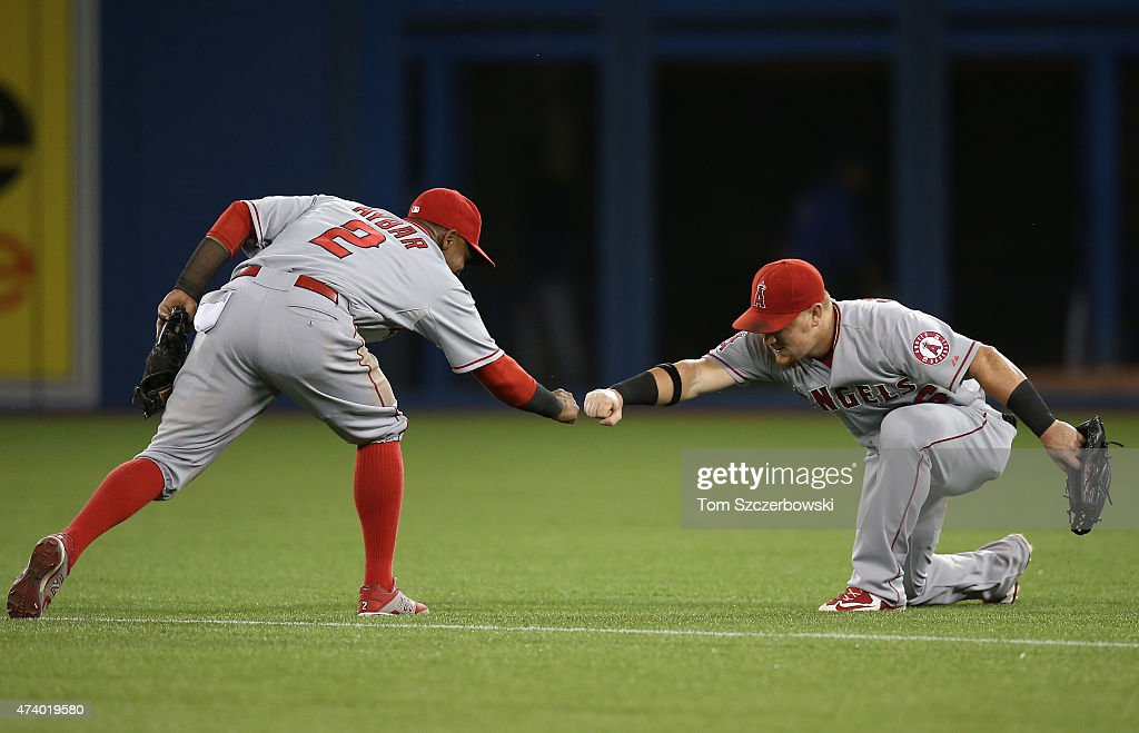 <a gi-track='captionPersonalityLinkClicked' href=/galleries/search?phrase=Kole+Calhoun&family=editorial&specificpeople=9008672 ng-click='$event.stopPropagation()'>Kole Calhoun</a> #56 of the Los Angeles Angels of Anaheim celebrates their victory with <a gi-track='captionPersonalityLinkClicked' href=/galleries/search?phrase=Erick+Aybar&family=editorial&specificpeople=551376 ng-click='$event.stopPropagation()'>Erick Aybar</a> #2 during MLB game action against the Toronto Blue Jays on May 19, 2015 at Rogers Centre in Toronto, Ontario, Canada.