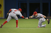 Kole Calhoun of the Los Angeles Angels of Anaheim celebrates their victory with Erick Aybar during MLB game action against the Toronto Blue Jays on...