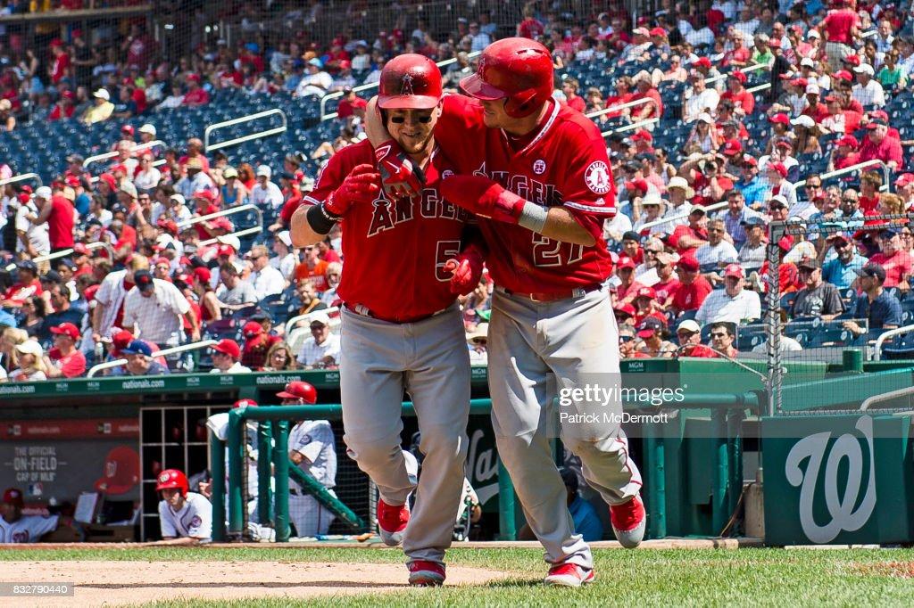 Kole Calhoun #56 of the Los Angeles Angels of Anaheim celebrates with Mike Trout #27 after hitting a two-run home run in the sixth inning during a game against the Washington Nationals at Nationals Park on August 16, 2017 in Washington, DC.