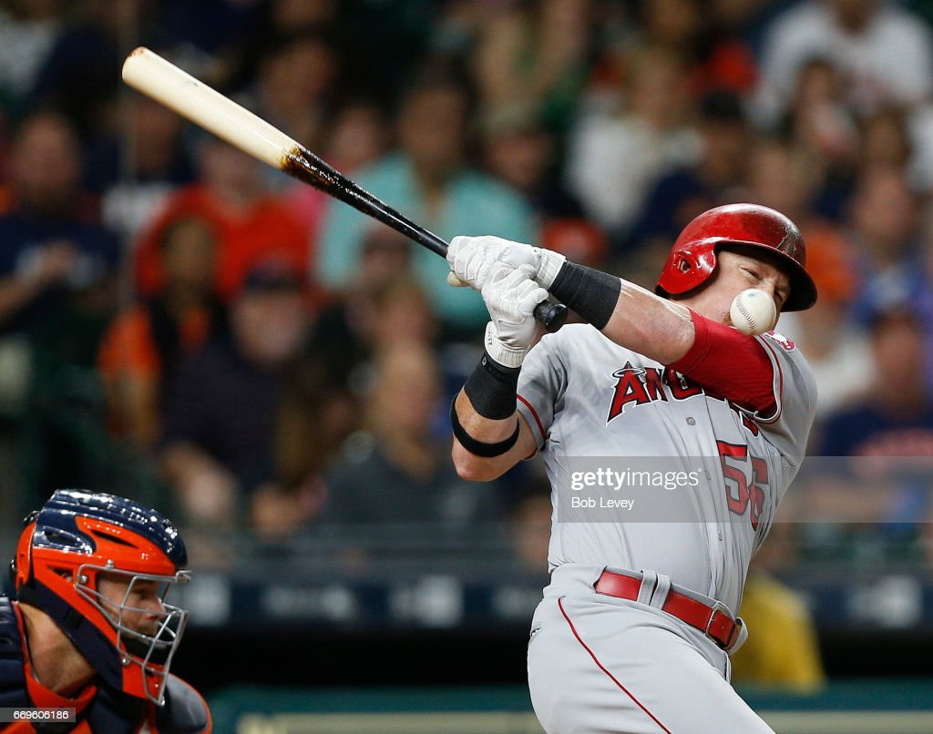 Kole Calhoun #56 of the Los Angeles Angels of Anaheim fouls the ball off his face against the Houston Astros at Minute Maid Park on April 17, 2017 in Houston, Texas.