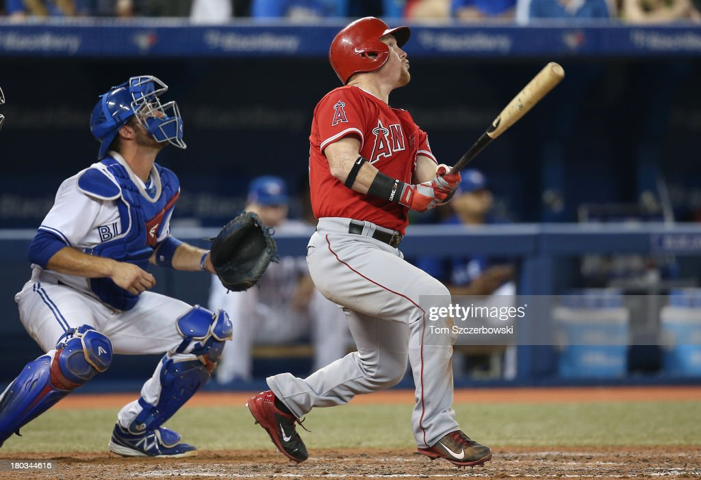Kole Calhoun #56 of the Los Angeles Angels of Anaheim hits a sacrifice fly RBI in the eighth inning during MLB game action against the Toronto Blue Jays on September 11, 2013 at Rogers Centre in Toronto, Ontario, Canada.