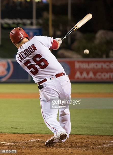 Kole Calhoun of the Los Angeles Angels of Anaheim hits a single during the third inning of the game against the Seattle Mariners at Angel Stadium of...