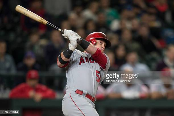 Kole Calhoun of the Los Angeles Angels of Anaheim hits a tworun home run off of relief pitcher Edwin Diaz of the Seattle Mariners that scored Cameron...