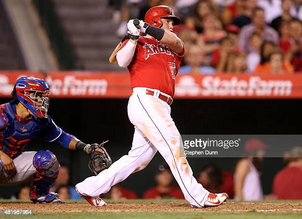 Kole Calhoun of the Los Angeles Angels of Anaheim hits an RBI single in the sixth inning against the Texas Rangers at Angel Stadium of Anaheim on...
