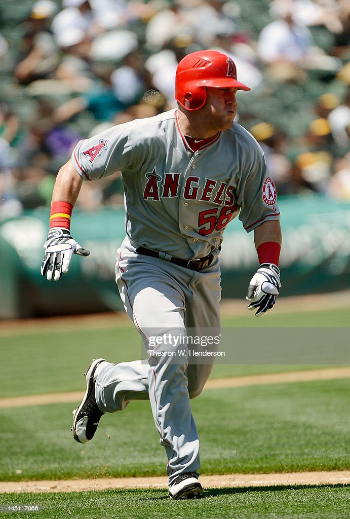 Kole Calhoun #56 of the Los Angeles Angels of Anaheim hustles down the line and on his way to second with a double for his first major league hit in the fifth inning against the Oakland Athletics at O.co Coliseum on May 23, 2012 in Oakland, California.