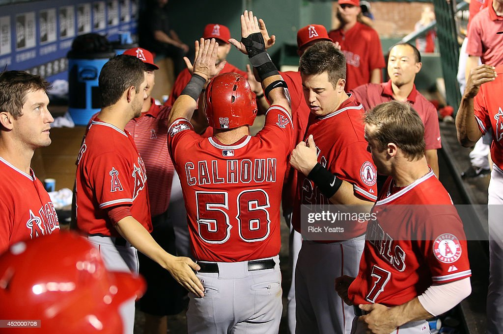 <a gi-track='captionPersonalityLinkClicked' href=/galleries/search?phrase=Kole+Calhoun&family=editorial&specificpeople=9008672 ng-click='$event.stopPropagation()'>Kole Calhoun</a> #56 of the Los Angeles Angels of Anaheim is congratulated for scoring in the eighth inning on a single RBI hit by Albert Pujols at Globe Life Park in Arlington on July 10, 2014 in Arlington, Texas.