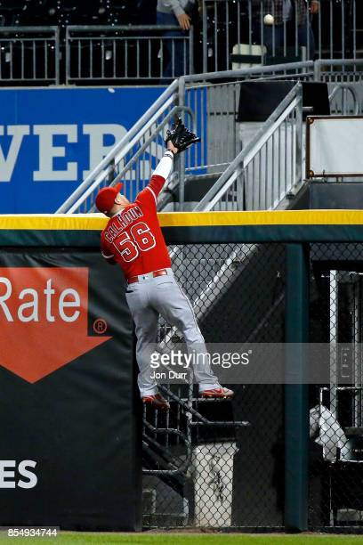 Kole Calhoun of the Los Angeles Angels of Anaheim is unable to catch the walkoff tworun home run of Nicky Delmonico of the Chicago White Sox during...