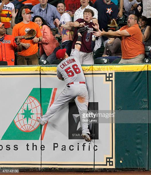 Kole Calhoun of the Los Angeles Angels of Anaheim leaps at the wall but cannot make a catch on a home run by Jason Castro of the Houston Astros in...